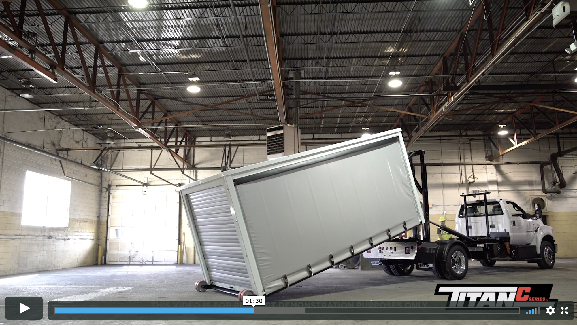 Titan® C-Series video showcases Miller Industries roll-off system for equipment and freight transport.