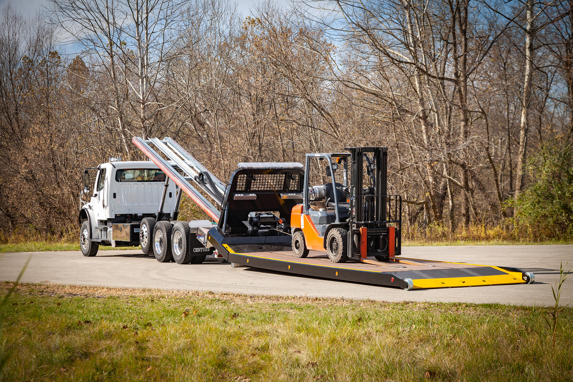 titan zla on white Freightliner m2 chassis with forklift bed on ground zero load angle