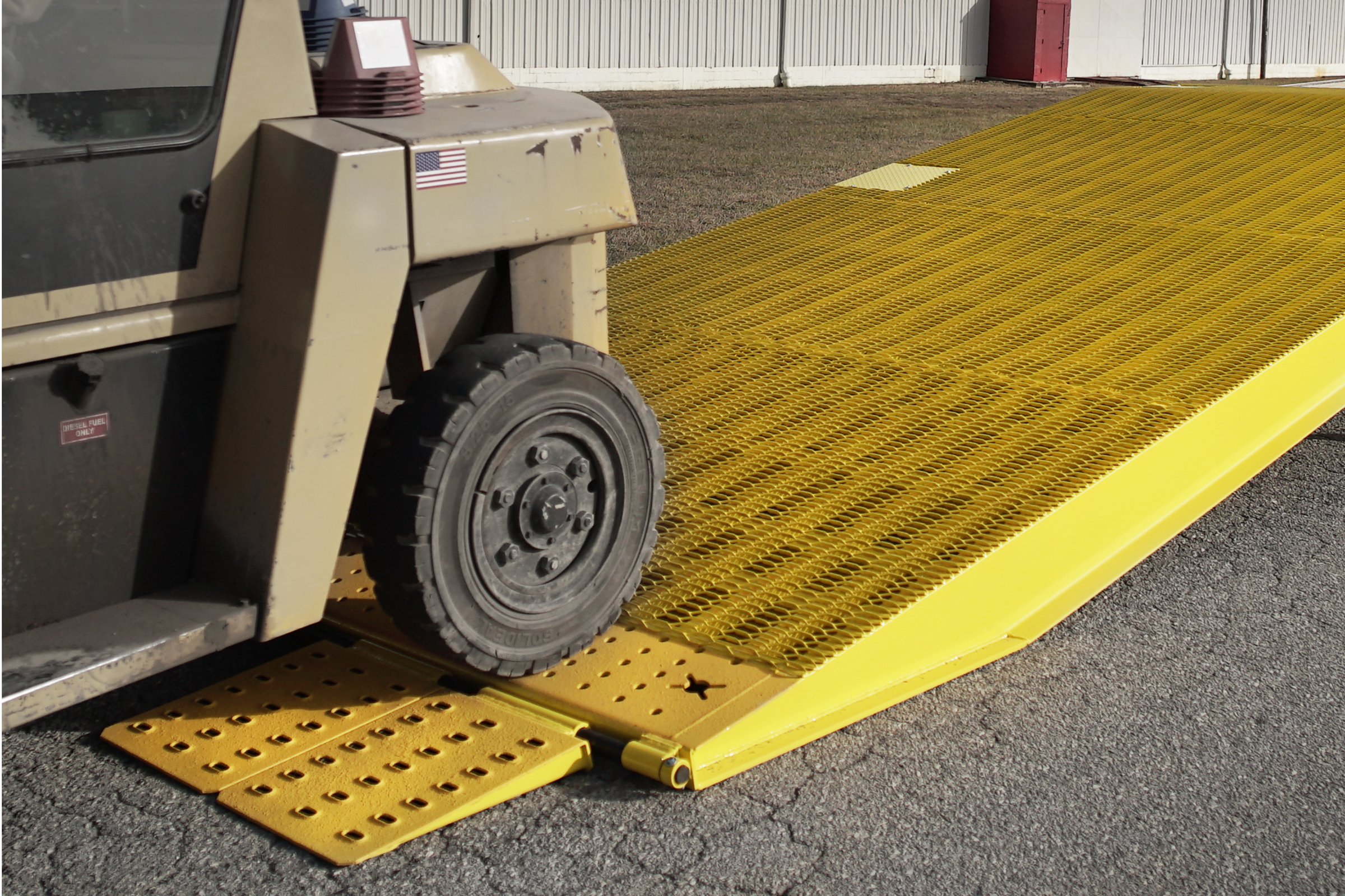 Special Transport Miller The portable Yard Ramp from Miller Industries allows loading without a loading dock.