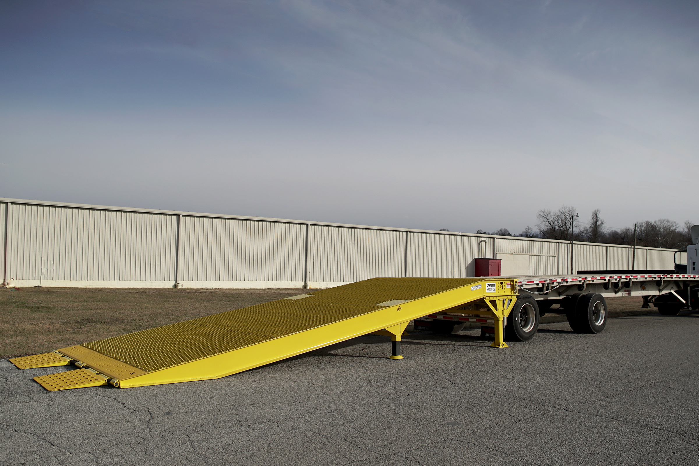 Special Transport Miller Need more warehouse loading docs.  Just get a Miller Industries Yard Ramp.