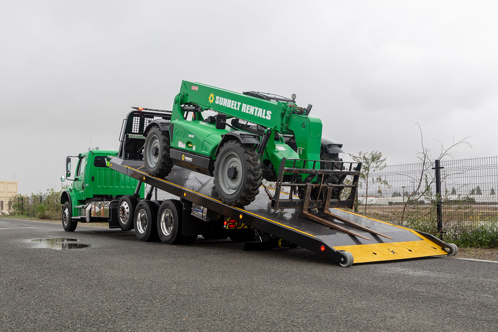titan zla on green Freightliner m2 chassis loaded bed at angle