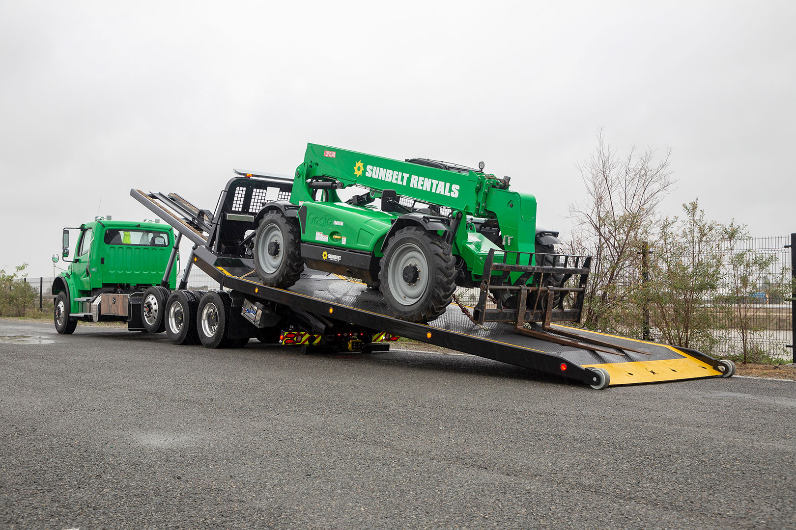 titan zla on green Freightliner m2 chassis bed at angle loaded with equipment