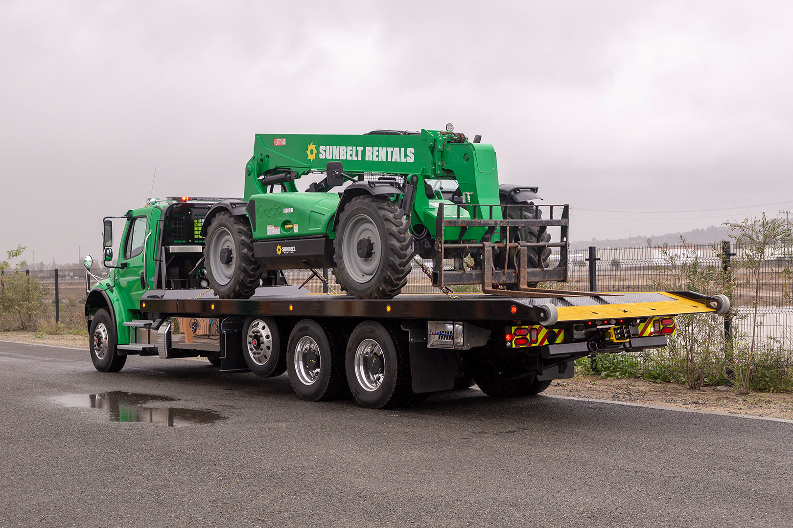 titan zla on green Freightliner m2 chassis bed stowed loaded with equipment